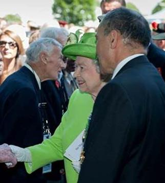 Pen talks with Prince Philip just after being introduced to Her Majesty The Queen